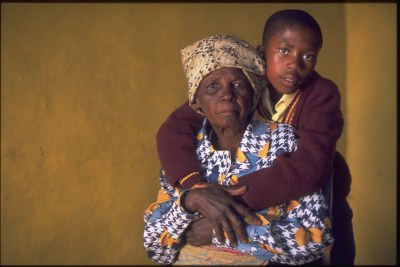 In Lesotho, a boy embraces his grandmother in their home in a village on the outskirts of Maseru.