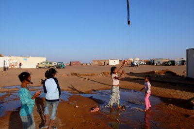 Sahrawi refugee camp Dakhla in southwest Algeria. Girls playing with water.