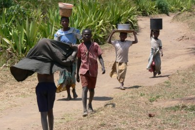 Children hauling water in Malawi.