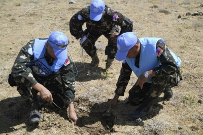 UN Disposal Unit uncovers an anti-tank mine.