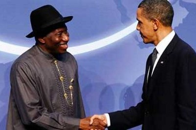 Presidents Goodluck Jonathan and Barack Obama shake hands at the Nuclear Security Summit in Washington in 2010 (file photo).