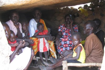 Displaced family in cave on the top of al-Labu Umudwal mountain, Southern Kordofan.