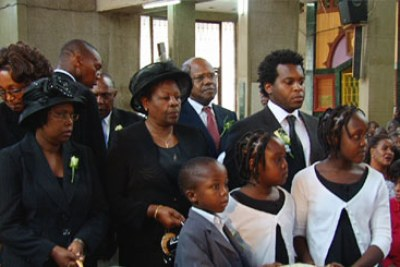 Zachary Musengi, far right, stands next to his mother, Margaret, as they mourn the late George Saitoti.