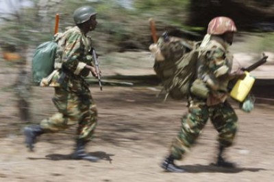 Kenya Defence Force jets attack al Shabaab stronghold of Kismayu in Somalia, destroying a warehouse and the armoury at the main airport.