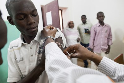Hospital staff are inoculated against yellow fever before seeing patients (file photo).