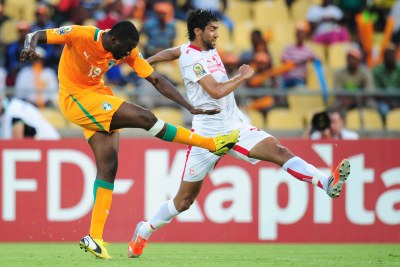 African Footballer of the Year Yaya Toure scoring one of Cote d'Ivoire's goals against Tunisia.