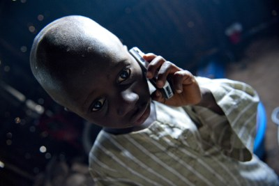 A child with a mobile phone.