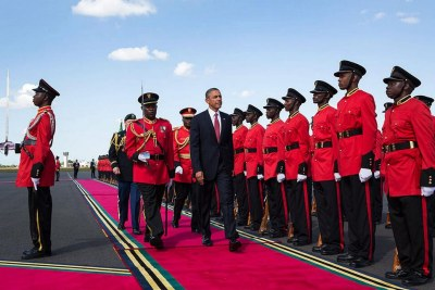 President Obama reviews Tanzanian troops at an airport arrival ceremony in Dar es Salaam.