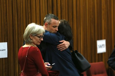 Paralympian Oscar Pistorius is seen with family and friends at the high court in Pretoria.