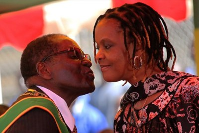 President Robert Mugabe kissing his wife Grace (file photo).