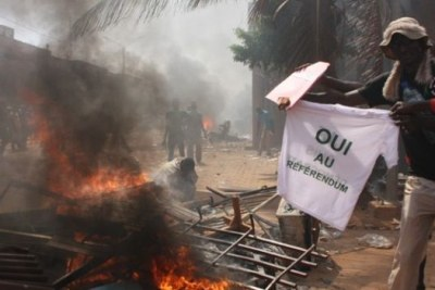 A protester burns a T-shirt supporting a referendum on constitutional changes to allow the president to stand for re-election in 2015 (file photo).