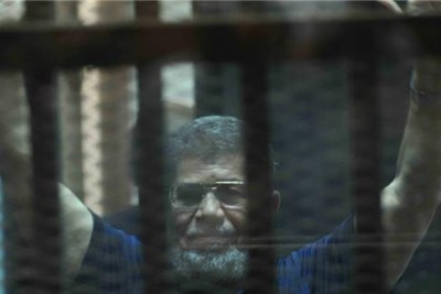 Ousted president Mohamed Mursi on trial.