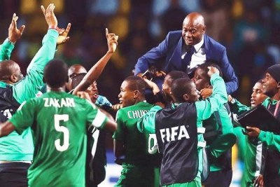 Emmanuel Amuneke celebrates with the Golden Eaglets players - most of whom are now part of the U-20 side that will face Burundi.