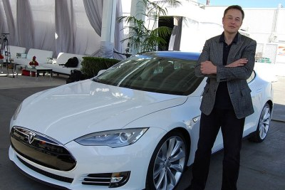 Tesla founder Elon Musk standing in front of a Model S (file photo).