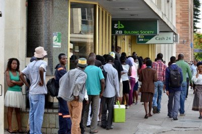 People at a bank waiting for service in Zimbabwe (file photo).