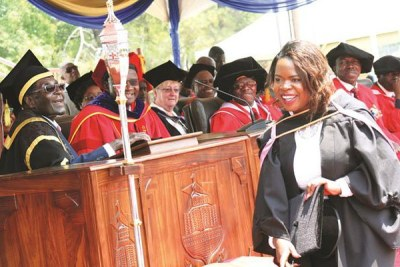 President Robert Mugabe caps Maud Chifamba who is the youngest student to graduate from the University of Zimbabwe.