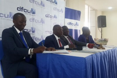 Left to right: dfcu Bank executive director William Sekabembe, managing director Juma Kisaame, chairman Jimmy Mugerwa and company secretary Agnes Tibayeta Isharaza address journalists in Kampala.
