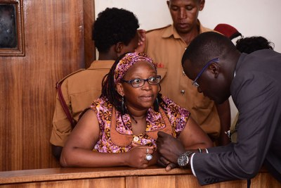 Stella Nyanzi with her lawyer Nicholas Opiyo.