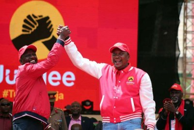 Deputy President William Ruto (left) and President Uhuru Kenyatta at the launch of Jubilee Party at Safaricom Stadium Kasarani in Nairobi on September 10, 2016.
