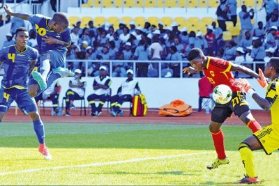 Tanzania's  Serengeti Boys striker Kelvin Naftal heads the ball past Angola goalkeeper Nsesani Simao to open the scoring during their Group B match at the U-17 Africa Cup of Nations (AFCON) 2017 at the Stade de l'Amitie Stadium in Brazzaville, Gabon. Boys won 2-1.