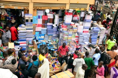 A cross-section of traders and customers at one of the busiest sections of Kikuubo Trading Centre in Kampala (file photo).