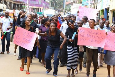 Nurses demonstrate in the streets of Kisii over the failure by the national and county governments to honour their collective bargaining agreement.