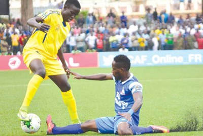 KCCA youngster Julius Poloto (L) earned a starting place against Rivers United yesterday but victory eluded his side.