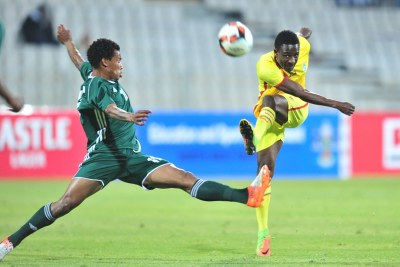 Talent Chawapiwa of Zimbabwe challenged by Tsoanelo Koetle of Lesotho during 2017 Cosafa Castle Cup match between Lesotho and Zimbabwe at Moruleng Stadium in Rustenburg on 05 July 2017.
