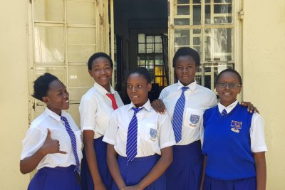 From left: Stacy Owino, Purity Achieng, Ivy Akinyi, Synthia Otieno and Macrine Atieno outiside a classroom in school. The five girls from Kenya will be representing Africa in the annual Technovation challenge in San Francisco.
