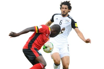 Uganda's Miya, left, will face Egypt's Hegazy at Borg El Arab stadium tonight.