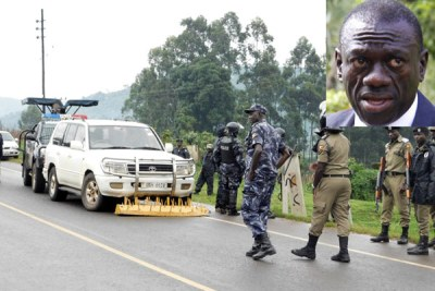 Police officers block Kizza Besigye's car shortly after he was intercepted on his way to Kabale on October 19, 2017. Inset is Dr Besigye.