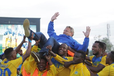 Rwanda Football team players lift up head coach Antoine Hey after 0-0 draw at Kigali stadium yesterday.