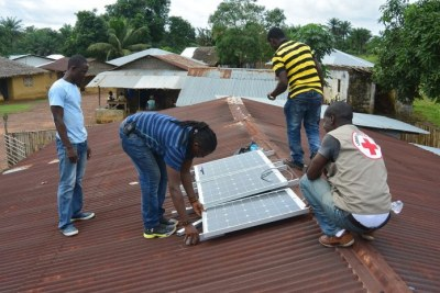 Solar light installation in Bomi County.