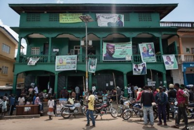 Campaign banners hang from the balconies of the Sierra Leone People's Party headquarters in Bo, Sierra Leone