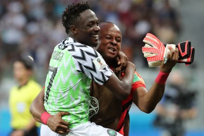 Scorer Ahmed Musa and goalkeeper Ikechukwu Ezenwa celebrate Nigeria's 2-0 win over Iceland at a World Cup game in Volgograd.