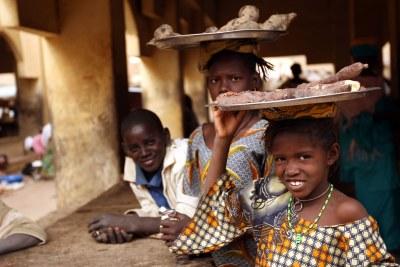 Children selling cassava roots near Timbuktu (file photo).