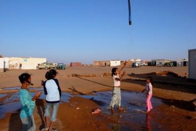 Sahrawi refugee camp Dakhla in southwest Algeria. Girls playing with water.