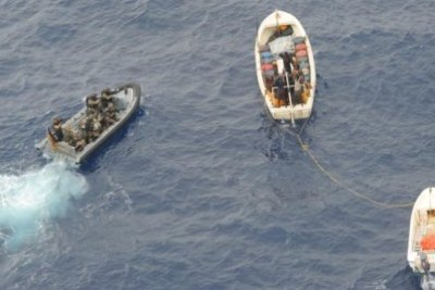 EUNAVFOR soldiers apprehend a group of suspected pirates.