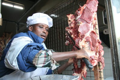 A butcher slices a piece of meat in butchery (file photo).
