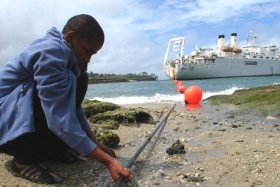 A boy holds the Kenyan Seacom cable (file photo): Despite wanting to link its ICT network to Kenya's submarine cables, the country is installing the incorrect fibre optic cables, experts say.