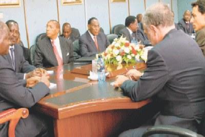 President Mwai Kibaki and Prime Minister Raila Odinga hold talks with ICC Chief Prosecutor, Louis Moreno Ocampo.