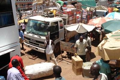Ugandan vehicles loaded with goods.
