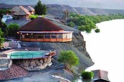 Sections of tourist lodges on the southern border of Namibia have been flooded by the rising waters of the Orange River.