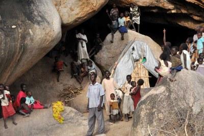 Displaced Nuban people hiding in caves in the Nuba Mountains, South Kordofan, Sudan, June 2012.