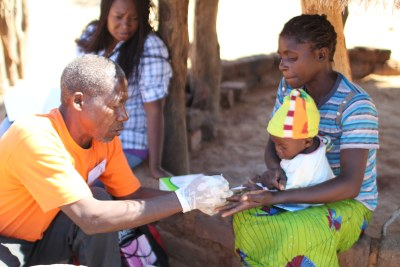 A mother and her son are tested for malaria.
