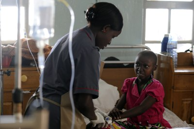 Nurse treating a young patient at the Uganda Cancer Institute (file photo).
