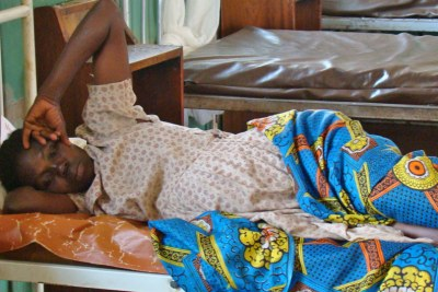 A mother awaits treatment at a health centre (File photo)