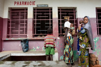 A group of mothers with their children line up to receive their drugs at a hospital pharmacy in Bossangoa, in the northwest region.
