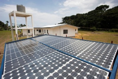 Solar power panels generate energy for a local administrative building in Liberia.