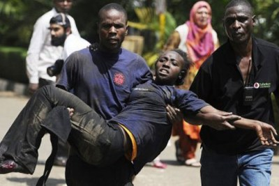 A survivor is carried out of Westgate Mall in Nairobi, Kenya, where armed gunmen opened fire and reportedly killed up to 30 people and wounded dozens (file photo).